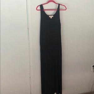 Black dress-ankle length; knee high slits.